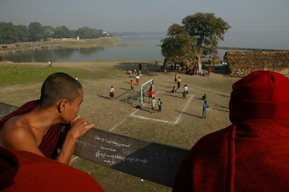 monks watch football