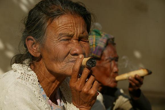 women smoking cheroot cigars