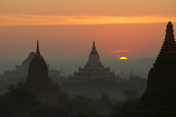 temple silhouettes at sunset, Pagan